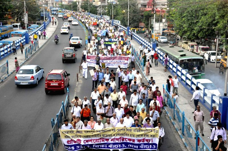 People participate in a rally to protest against attack on students of Jadavpur University by ABVP activists in Kolkata, on May 12, 2016.