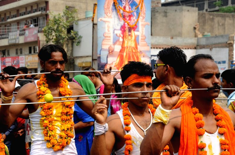 People participate in a religious procession organised to honour Maha Mariamman in Amritsar, on May 8, 2016.