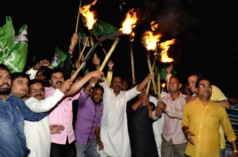 People participate in a torchlight demonstration to protest against Jharkhand government's domicile policy in Ranchi, on May 13, 2016.