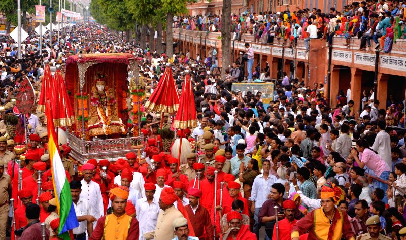 People participate in a traditional Teej procession at Tripoli Gate of in Jaipur on July 30, 2014.