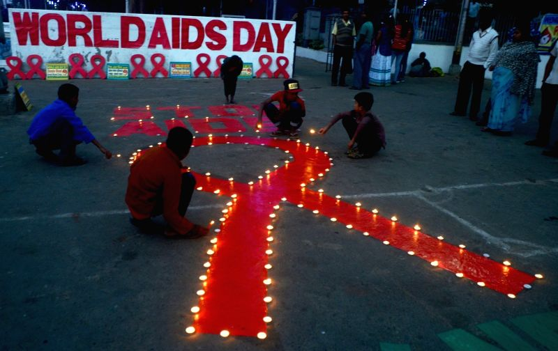 People participate in an awareness programme organised on World AIDS Day in Kolkata on Dec 1, 2017.
