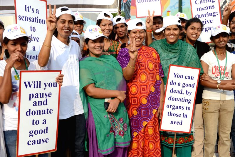 People participate in an 'Organ Donation' awareness rally at Freedom Park in Bangalore on April 27, 2014.