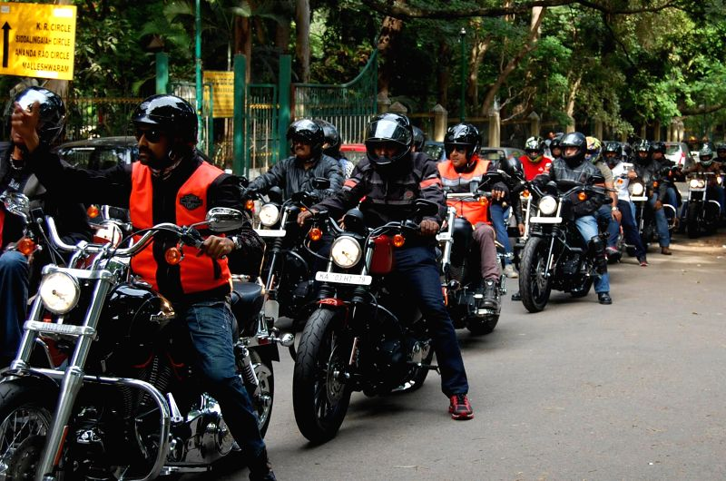 People participate in Bike rally for creating awareness on Mouth Diseases and Mouth Cancer from Cubbon Park to MS Ramaiah College, in Bangalore on June 28, 2014.