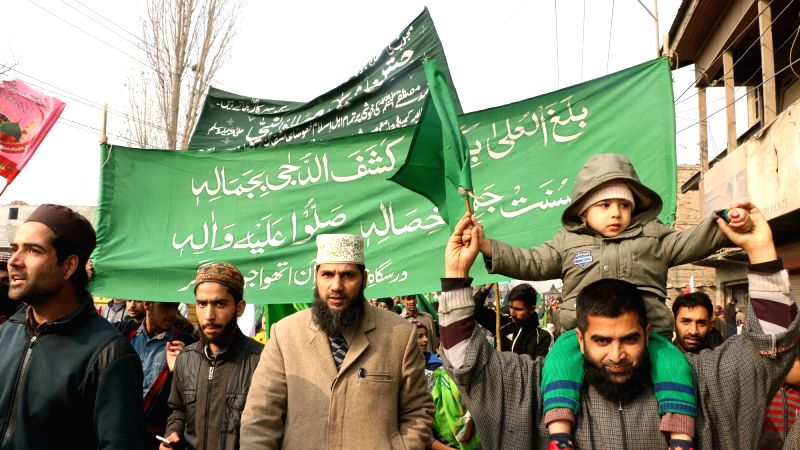 People participate in Eid Milad-un-Nabi (SAW) procession in Srinagar on Dec 1, 2017.