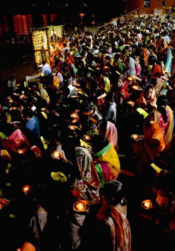People participate in Ganga aarti on Ganga Dussehra on the banks of Hooghly river in Kolkata, on June 4, 2017.