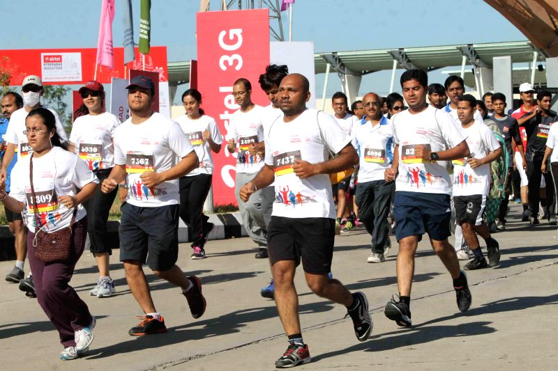 People participate in Hyderabad Marathon on Aug 24, 2014.