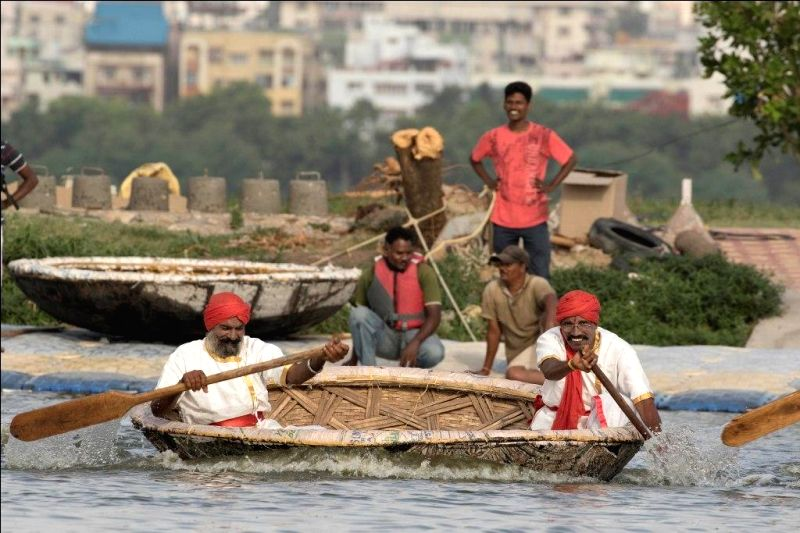 People participate in India's first Coracle Regatta to mark 'Telangana Formation Day' at Yacht Club in Hussain Sagar lake; in Hyderabad, on May 31, 2016.
