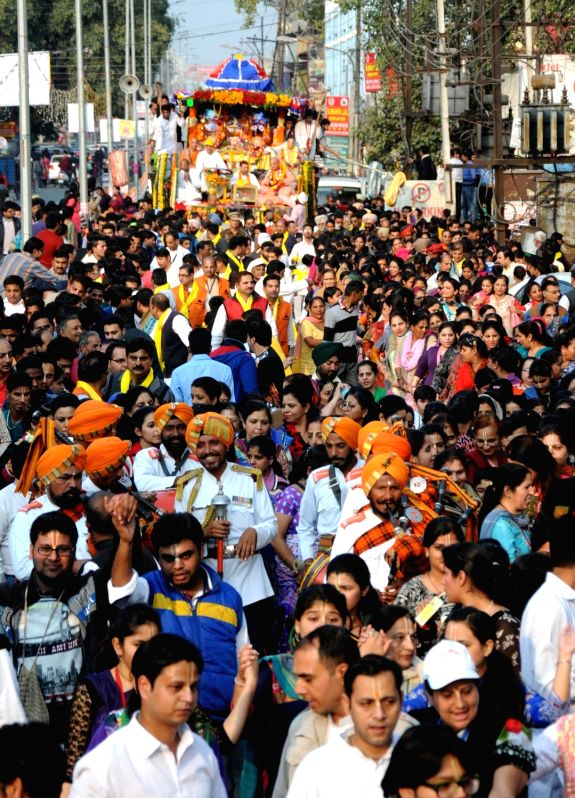 People participate in Jagannath Rath Yatra in Amritsar, on Nov 27, 2015.
