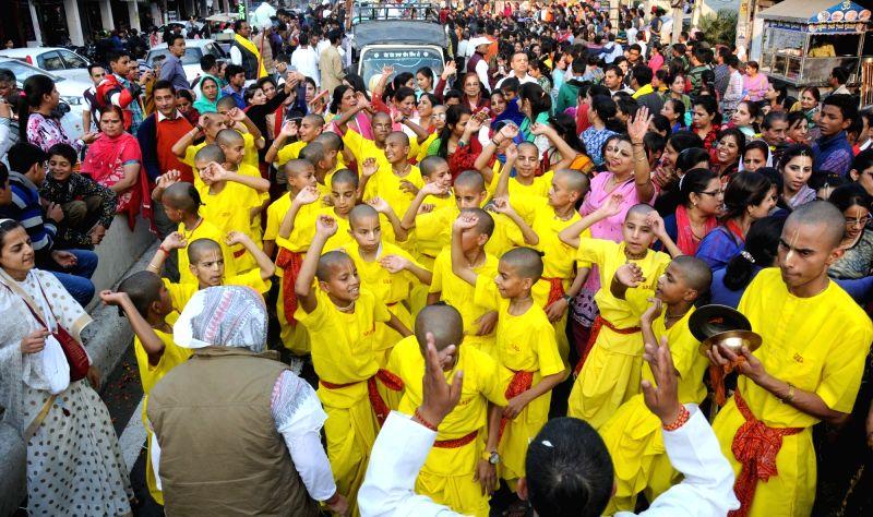 People participate in Jagannath Rath Yatra in Amritsar, on Nov 27, 2015.