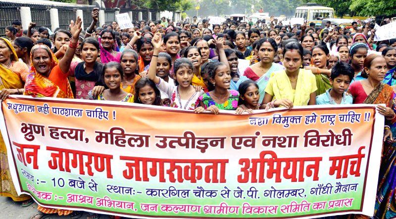 People participate in `Jan Jagran Jagrukta Abhiyan March` in Patna on June 30, 2014.