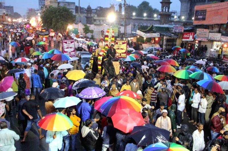 People participate in Mahankali Bonalu festival in Hyderabad, on July 17, 2017.