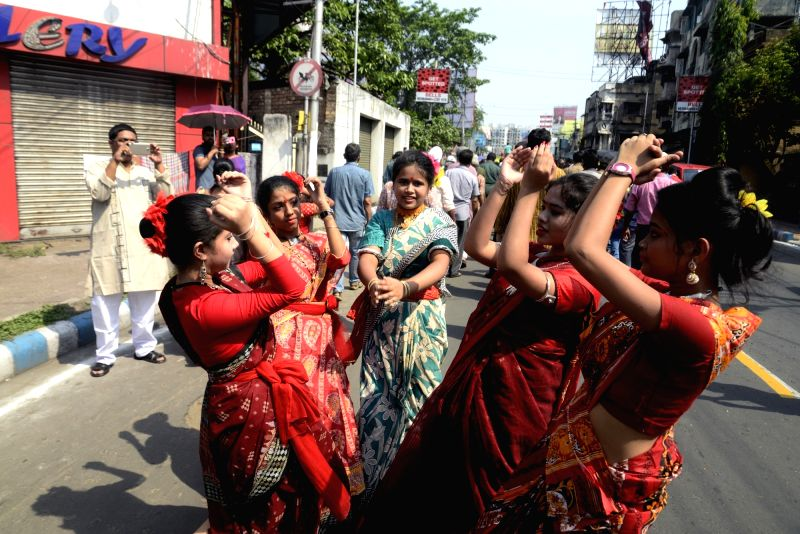 People participate in 'Mangal Shobhajatra' procession on Poyla Baishakh - Bengali New Year, in Kolkata on April 15, 2018.