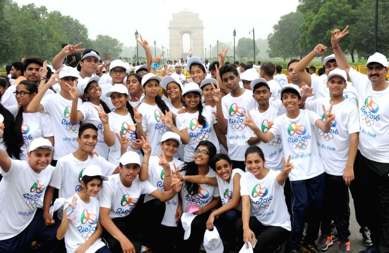 "People participate in ""Run for Rio"" in New Delhi on July 31, 2016."