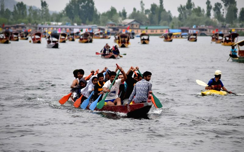 People participate in Shikara Festival in Dal Lake on Srinagar on May 2, 2017.