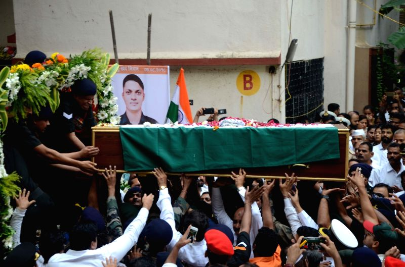People participate in the funeral procession of late Major Kaustubh P. Rane who was among the four soldiers killed in a gunfight with terrorists near the Line of Control (LoC) in Jammu and ...