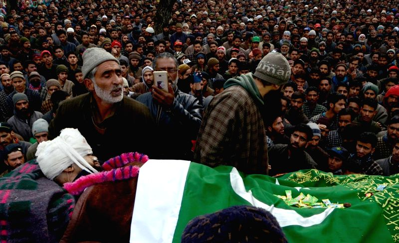 People participate in the funeral procession of a 19-year-old Rayees Ahmad who was injured in security force firing in Shopian district succumbed to injuries at Sher-e-Kashmir Institute of ...