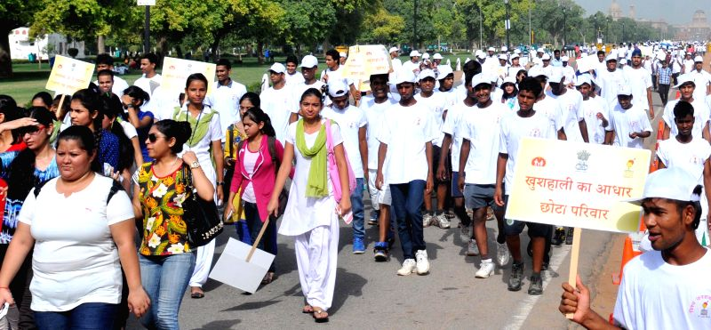 People participate in `Walkathon for Population Stabilization`organised on World Population Day in New Delhi on July 11, 2014.