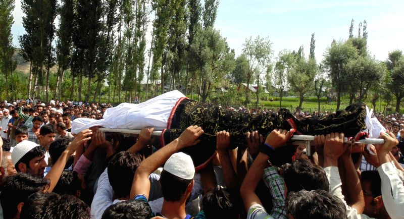 People participated in the funeral of a youth killed during the unrest in Kashmir valley at Baramulla on Aug. 6, 2016.