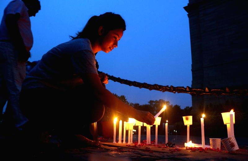 People pay homage by candle light to Kargil Martyrs at India Gate on the occasion of Kargil War Anniversary, in New Delhi on July 26, 2016.