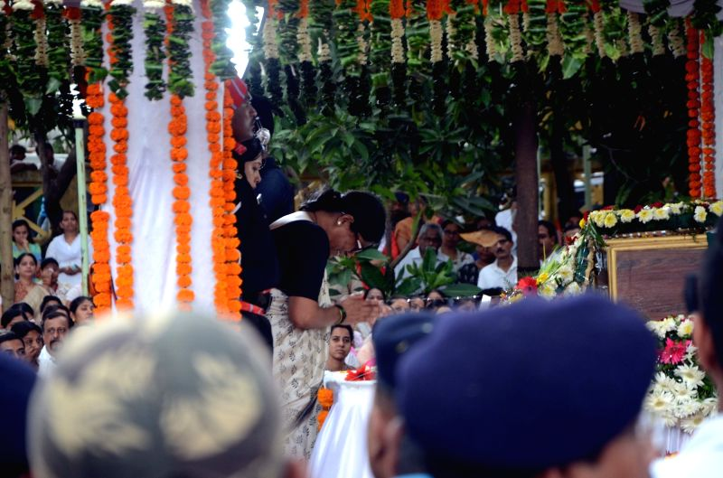 People pay homage to Major Kaustubh P. Rane ahead of his last rights, in Maharashtra's Thane on Aug 9, 2018. Thousands of people, including grieving family members, bid a tearful goodbye to ...