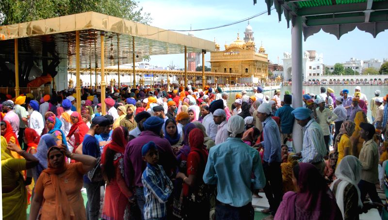 People pay obeisance at the Golden Temple on Baisakhi in Amritsar on April 14, 2014.