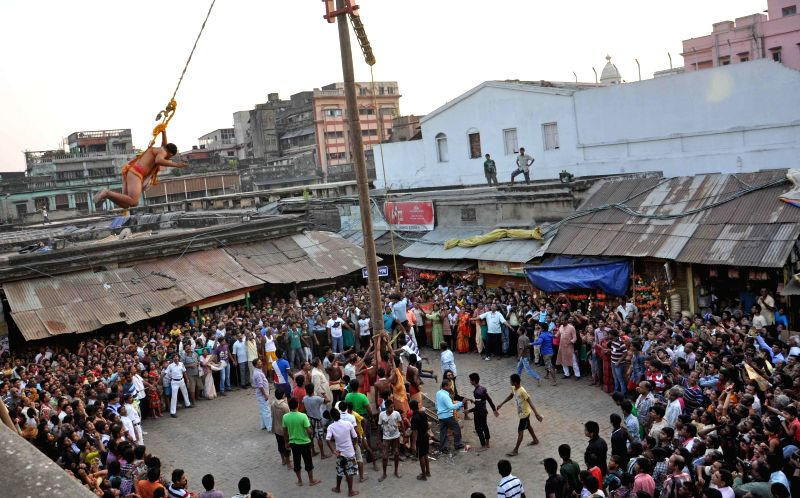 People perform during  'Charak' celebrations in Kolkata on April 14, 2014.
