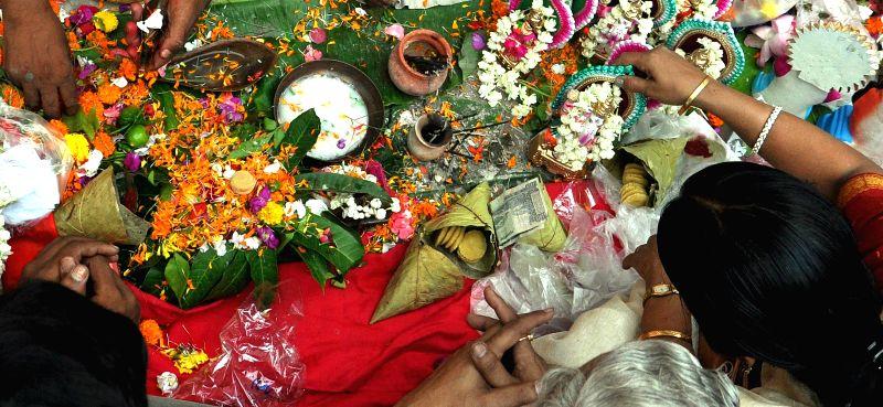 People perform puja on `Poila Baisakh`  in Kolkata on April 15, 2014.