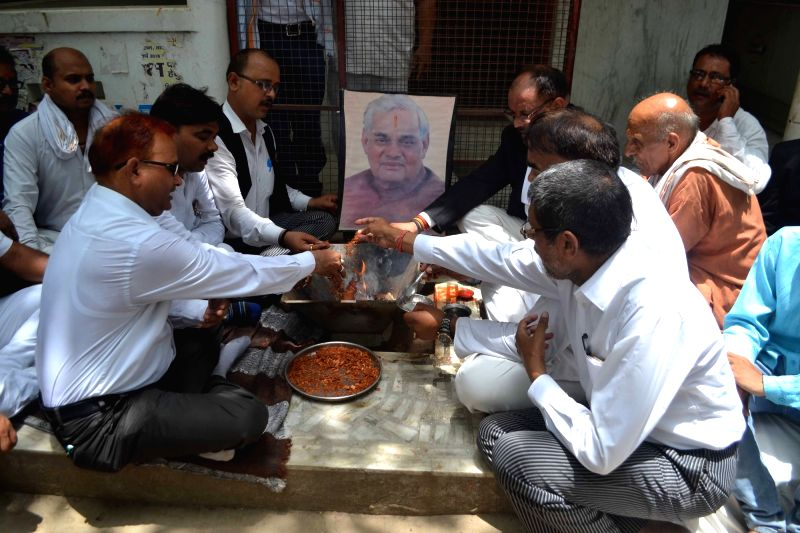 People perform yagya to pray for the speedy recovery of former Prime Minister Atal Bihari Vajpayee; in Varanasi on June 12, 2018. Vajpayee is battling a urinary tract infection and ... - Atal Bihari Vajpayee