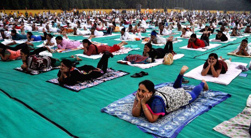 People performs Yoga at a camp in Kolkata, on Nov 19, 2015.