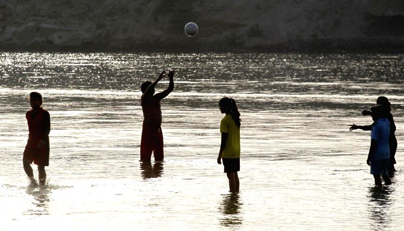 People play in water at Sangam of Allahabad on May 19, 2017.