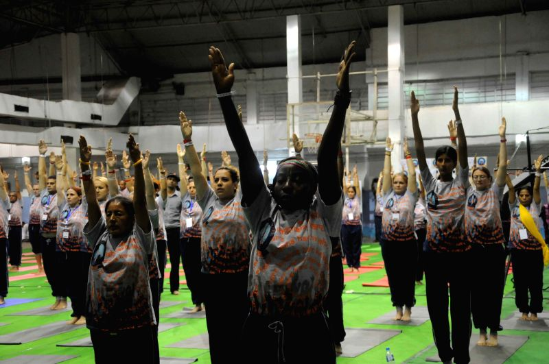 People practice Yoga on the Golden Jubilee celebrations of ISCKON in Kolkata, on Aug 13, 2015.