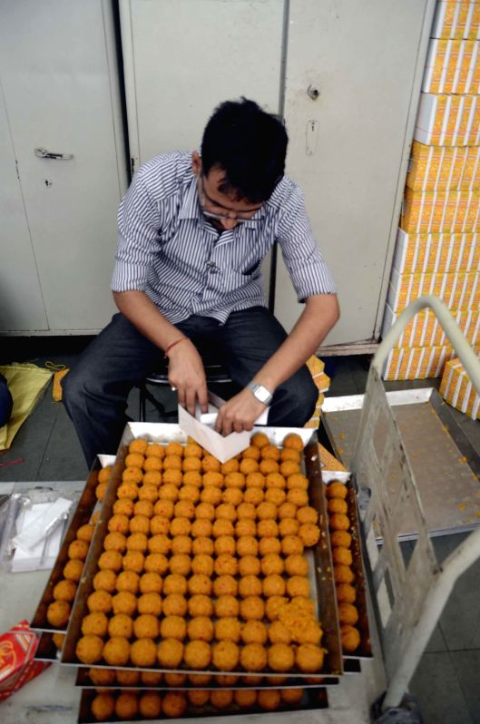 People prepare ladoo to meet the demand of the sweets ahead of declaration of the 2014 Lok Sabha Election results which are scheduled to be declared on 16th May; in Mumbai on May 14, 2014.