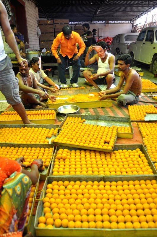 People prepare ladoo to meet the demand of the sweets ahead of declaration of the 2014 Lok Sabha Election results which are scheduled to be declared on 16th May; in Ranchi on May 15, 2014.