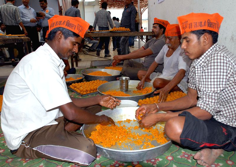 People prepare ladoo to meet the demand of the sweets ahead of declaration of the 2014 Lok Sabha Election results which are scheduled to be declared on 16th May; in New Delhi on May 15, 2014.