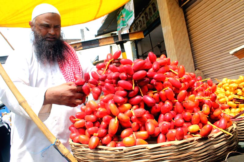 People purchase `Dubaia dates` during Ramadan in Hyderabad on July 4, 2014.