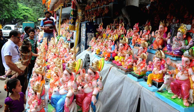 People purchase Gouri idols ahead of Gauri Ganesha Festival in Bangalore on Aug 28, 2014.