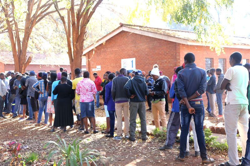 : People queue to vote in Kuwadzana, Harare, Zimbabwe, July 30, 2018. Zimbabweans began voting on Monday in the African country's first presidential election ...