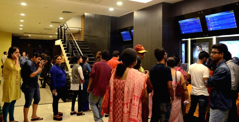 "People queue up at a Kolkata cinema hall to buy tickets for  ""Baahubali 2: The Conclusion"" on April 28, 2017."