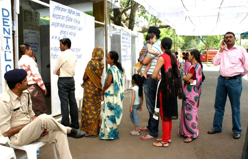 People queue-up to cast their votes at a polling booth during the fifth phase of 2014 Lok Sabha Polls in Bhopal on April 17, 2014.