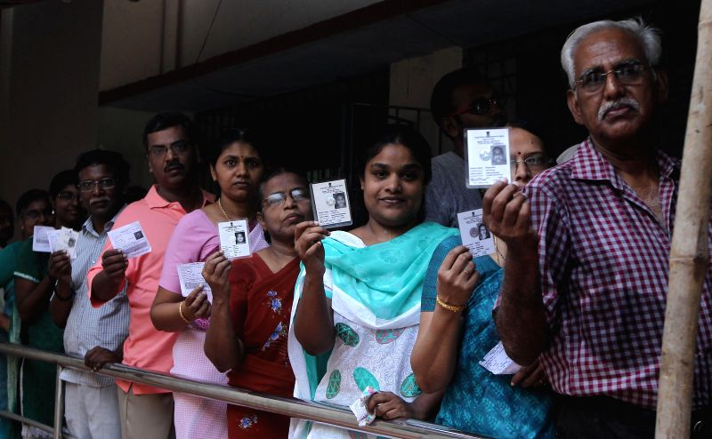 People queue-up to cast their votes at a polling booth at a polling booth during the sixth phase of 2014 Lok Sabha Polls  in Chennai on April 24, 2014.