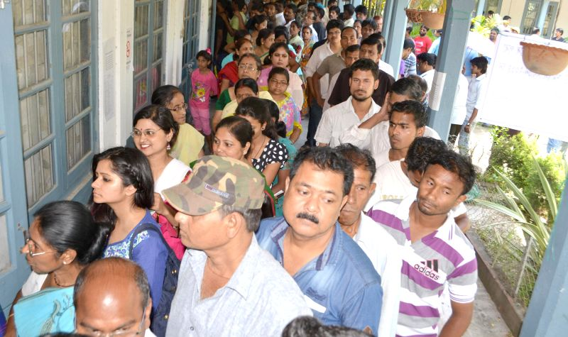 People queue-up to cast their votes at a polling booth during the sixth phase of 2014 Lok Sabha Polls in Guwahati on April 24, 2014.