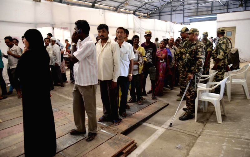 People queue-up to cast their votes at a polling booth during the sixth phase of 2014 Lok Sabha Polls in Dharavi of Mumbai on April 24, 2014.