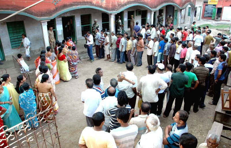 People queue-up to cast their votes at a polling booth during the seventh phase of 2014 Lok Sabha Polls in Howrah of West Bengal on April 30, 2014.