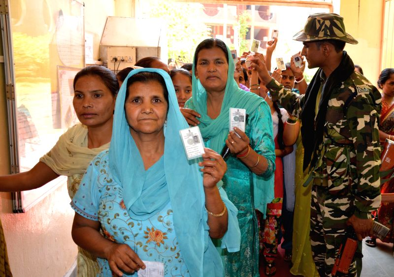 People queue-up to cast their votes at a polling booth during the seventh phase of 2014 Lok Sabha Polls in Amritsar on April 30, 2014.