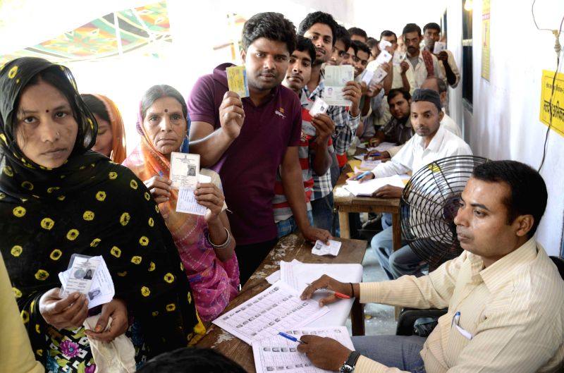 People queue-up to cast their votes at a polling booth during the eighth phase of 2014 Lok Sabha Polls in Hajipur of Bihar on May 7, 2014.