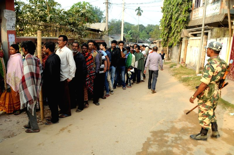 People queue-up to cast their votes at an Agartala polling booth during Tripura civic polls on Dec 9, 2015.