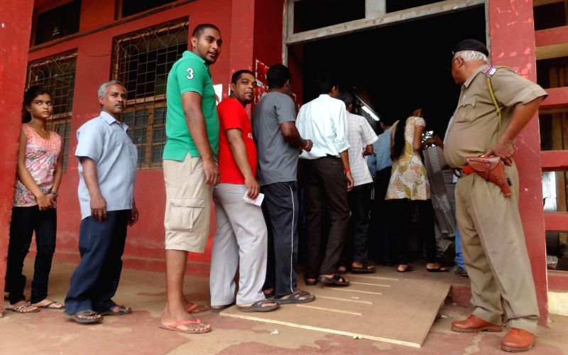 People queue-up to cast their votes at Taleigao panchayat elections near Panaji on April 27, 2014.