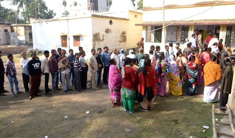 People queue-up to cast their votes during by-polls to Noapara assembly seat in West Bengal on Jan 29, 2018. Four candidates have thrown their hats into the ring for the Noapara seat, where ...