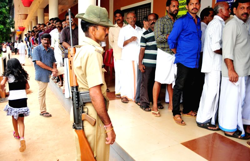 People queue-up to cast their votes during Kerala Assembly elections in Kannur of Kerala on on May 16, 2016.
