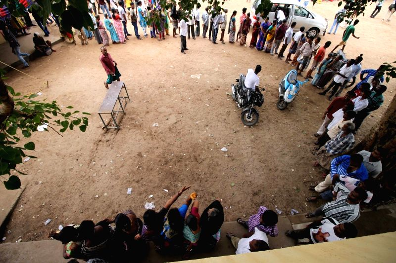 People queue-up to cast their votes during Tamil Nadu Assembly polls in Chennai  on May 16, 2016.